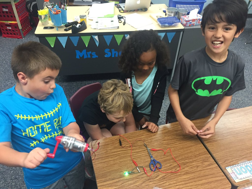 Third graders use a simple circuit to test objects as conductors or insulators. Courtesy NPPD.