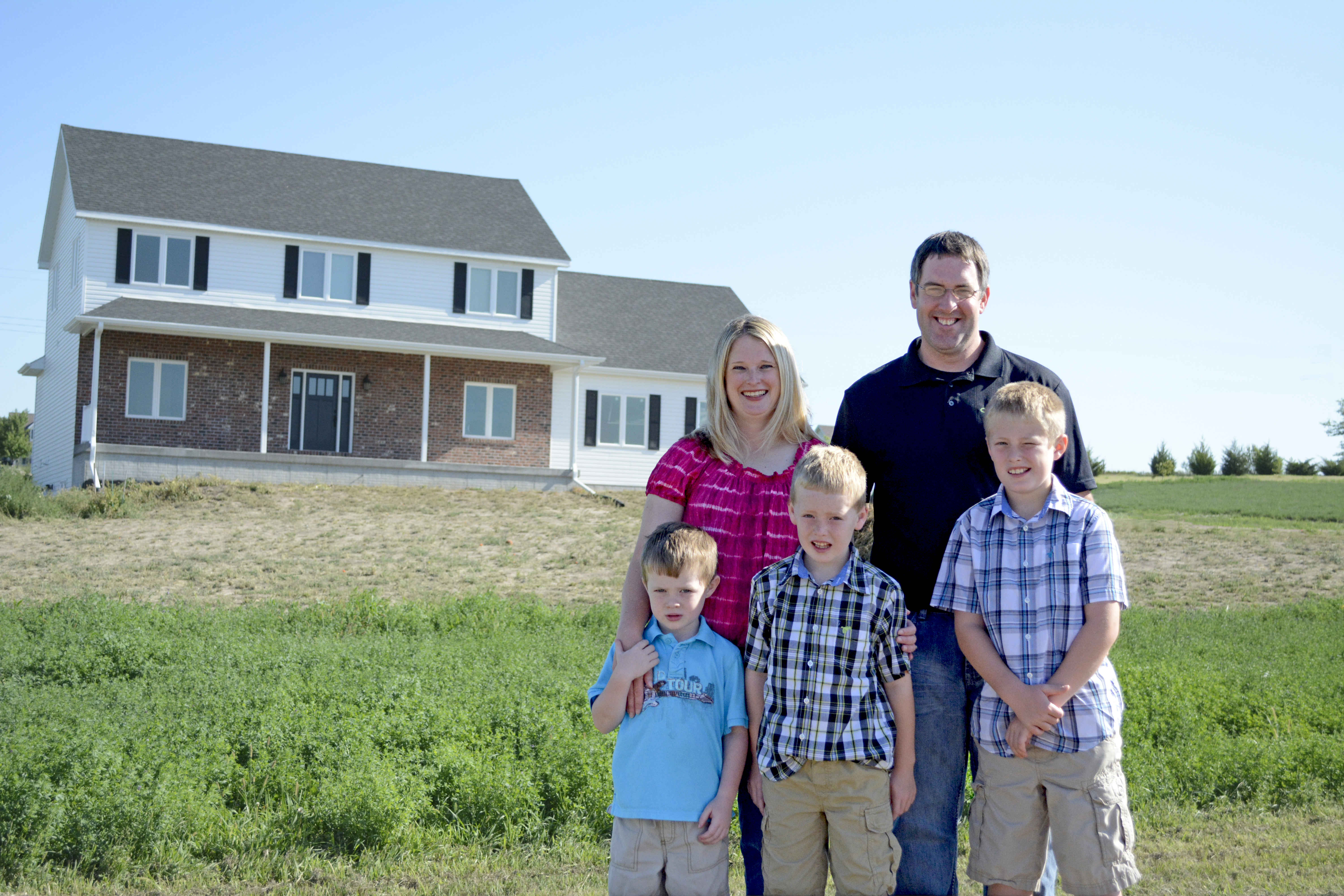 Johnson family in front of house