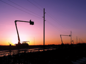 Bucket trucks working in the sunset. Photo courtesy Dave Behle.