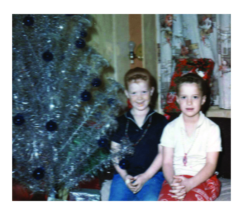 General Manager Gwen Kautz's (right) holiday memories include her sister, Dawn, and the beauty of a stylish aluminum Christmas tree.