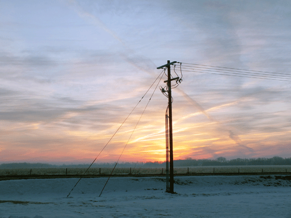 The sun rises on a foggy winter morning in rural Lexington, Nebraska.