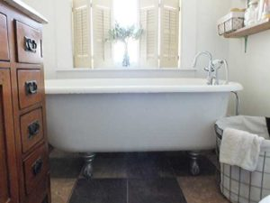 Guests may enjoy a relaxing bath in The Junkin Place's original claw foot tub while overlooking the spacious backyard.