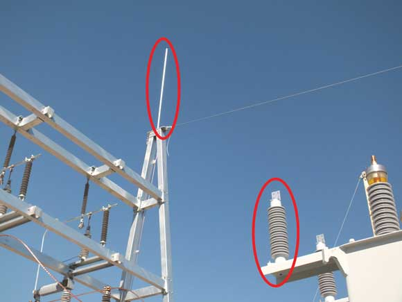 A lightning rod (left) and lightning arrestor (below) in a substation.