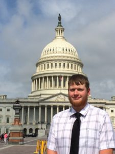 Mitchell Walters stands in front of the United States Capitol Building