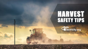Safe Electricity.org - Harvest safety tips. A combine drives through  a dusty field.
