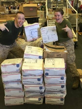 Military members show their excitement in receiving hard tac sticks through the Beefin' Up Our Heroes Program, Courtesy photo.