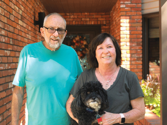 Neal and Joyce Boyd with their dog, Max.