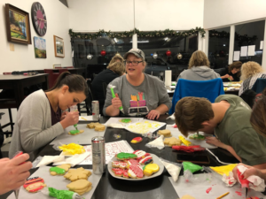Dawn Turner pauses to observe a student's technique during a cookie decorating class. She plans to offer monthly classes in 2020.