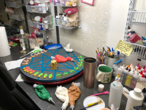 Turner's cookie decorating studio. She uses a lazy susan stacked with round trays to quickly decorate cookies and move them without disturbing the icing as it dries.
