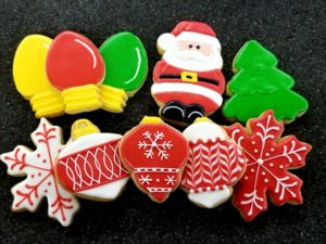 Dawn Turner's Christmas themed cookies included three Christmas light bulbs, Santa, a tree, two snowflakes and three ornaments.